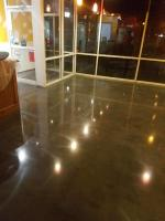 Black dyed concrete floor and polished with a sealer on top.