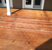 Front stairway patio area of a residential home got its concrete re-stained and resealed in Littleton, CO.