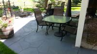 High end stain and sealer was used on this patio in Morrison Colorado.