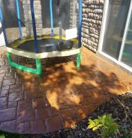 Stamped concrete was rejuvinated with stain and sealer on this outdoor patio.