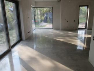 A residential basement floor is refinished with a high gloss polish of it's concrete.