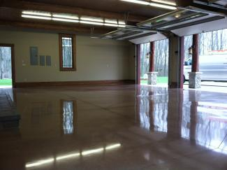a polished garage floor with stain.
